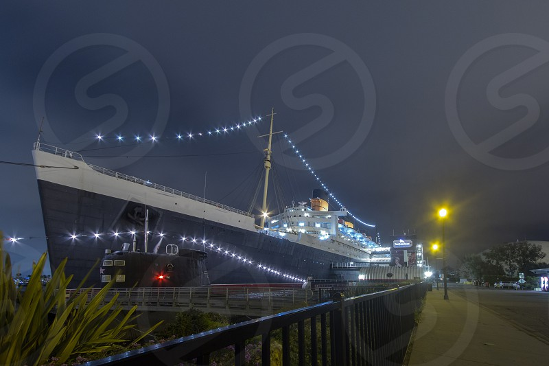 A foggy night photo of a ship in port.  photo