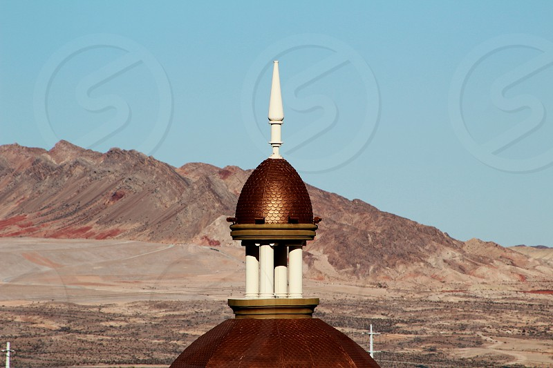 Steeple with mountain background photo