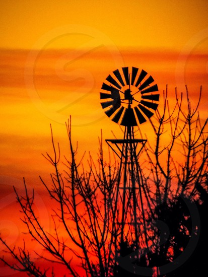 Windmill at sunrise.   photo