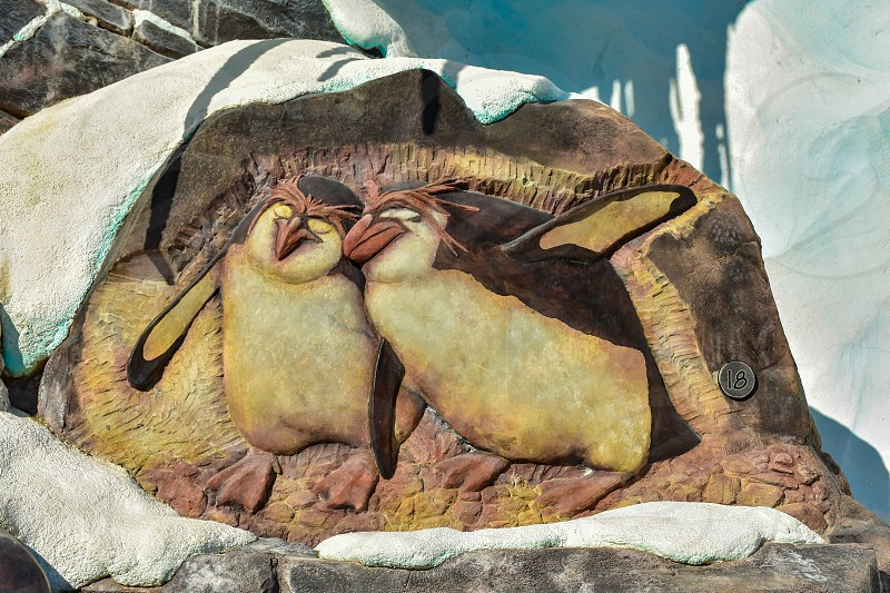 Orlando Florida . February 26  2019. Beautiful penguins carved in the rock at Seaworld Theme Park. photo