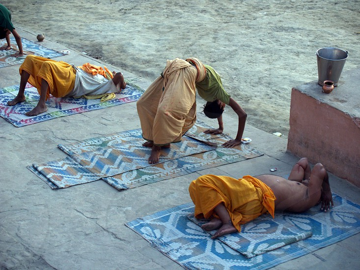 Morning yoga on the banks of the River Ganges in the city of Varanasi India photo