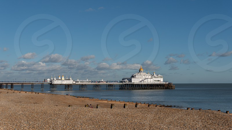 EASTBOURNE EAST SUSSEX/UK - JANUARY 28 : View of Eastbourne Pier in East Sussex on January 28 2019. Three unidentified people. photo