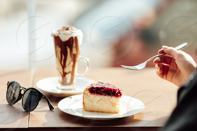 Pretty girl hold a plate of delicious cake and waer glasses. Sun shine photo with girl eat her cake photo