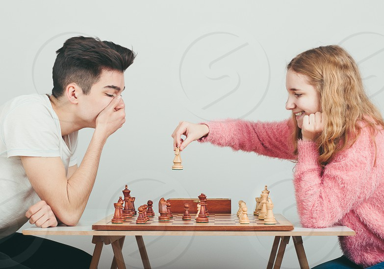Checkmate. Boy is surprised by last move his opponent in chess game. Copy space for text at the top of image photo