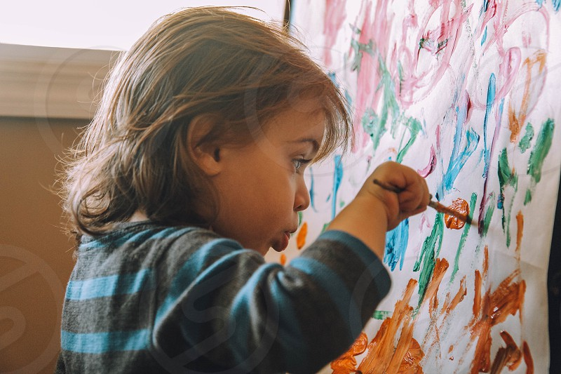 Toddler drawing with watercolors photo