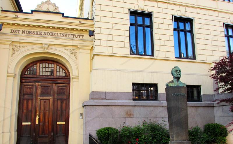 Norwegian Nobel Institute & The Alfred Nobel Statue. The Norwegian Nobel Institute (Nobelprize) building in Oslo  is placed on Henrik Ibsens gate 51 0255 Oslo Norway. photo