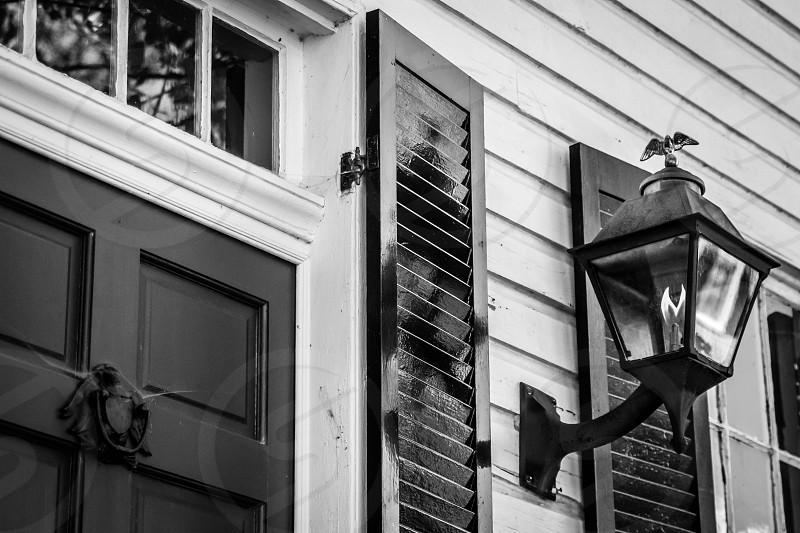 black and white black & white B&W Old Town Alexandria Virginia flame light lamp cob spider web door shutter photo