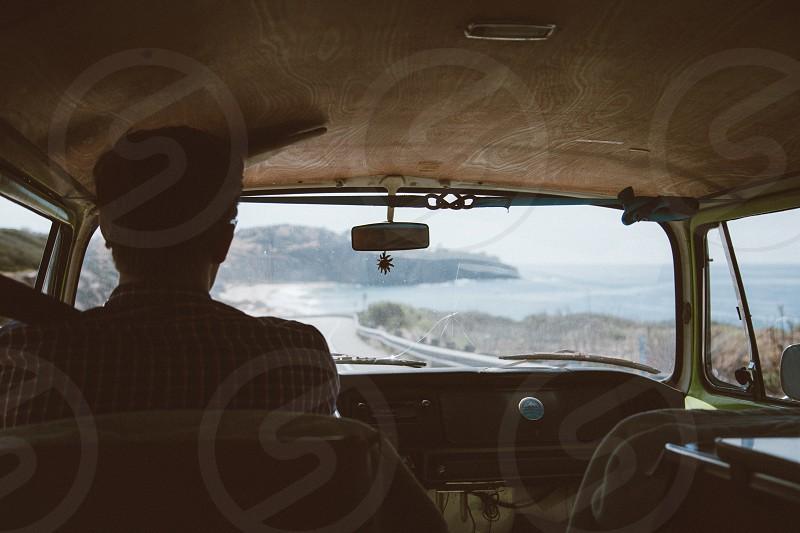 man behind the wheel of van photo