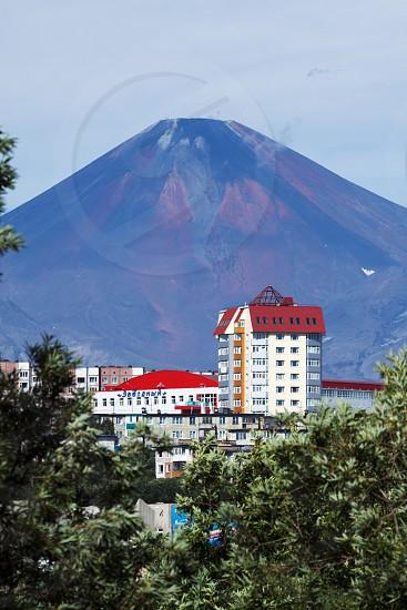 PETROPAVLOVSK-KAMCHATSKY KAMCHATKA RUSSIA - AUGUST 18 2012: Summer cityscape: view of Petropavlovsk-Kamchatsky City and beautiful active Avacha Volcano on a sunny day. Far East Russia. photo
