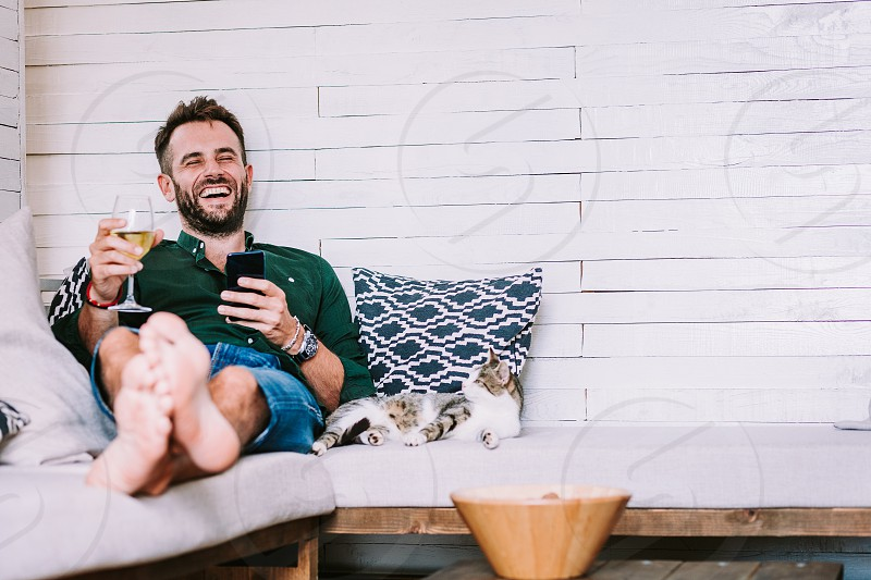 Young man using smartphone in the living room photo