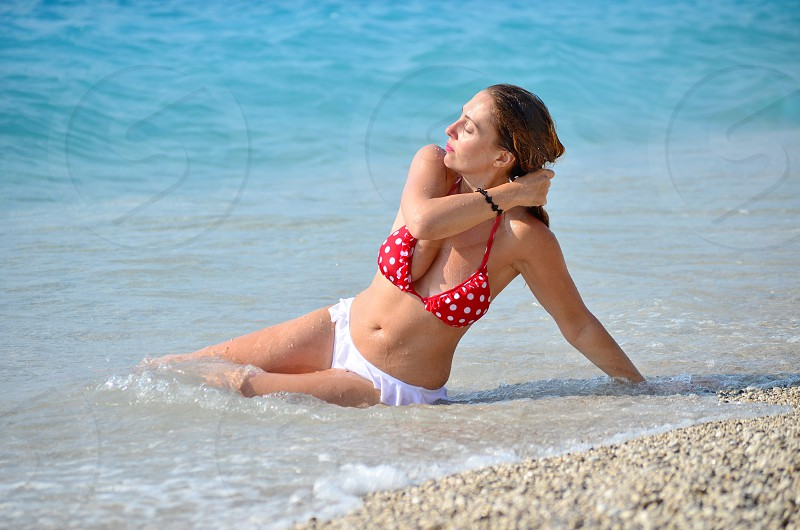 Beautiful woman lying in sea photo