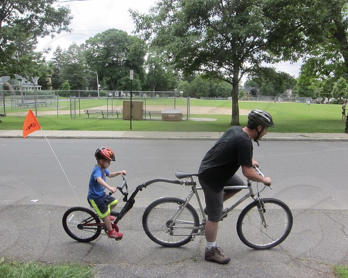 Bicycling with dad and son family fun outdoors activities lifestyle  photo