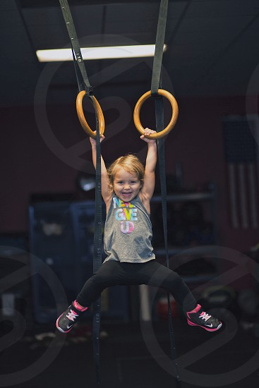 Happy and carefree toddler pretending to be a gymnast. photo