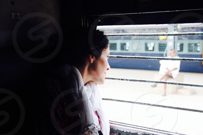 woman inside the train looking outside photo