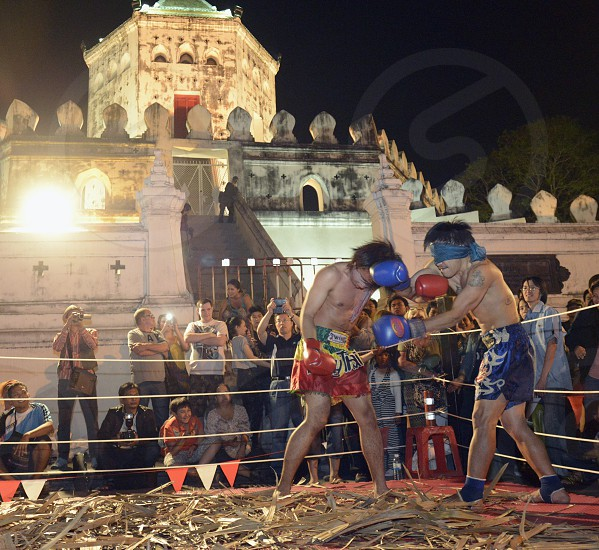 a Muay Thai show Boxing fight in front of the Fort Sumen by a nightmarket at the Santichaiprakan Park at the Mae Nam Chao Phraya River in the city of Bangkok in Thailand in Southeastasia. photo