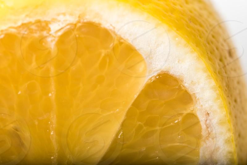 Macro shot of a sliced lemon on a white plate. photo