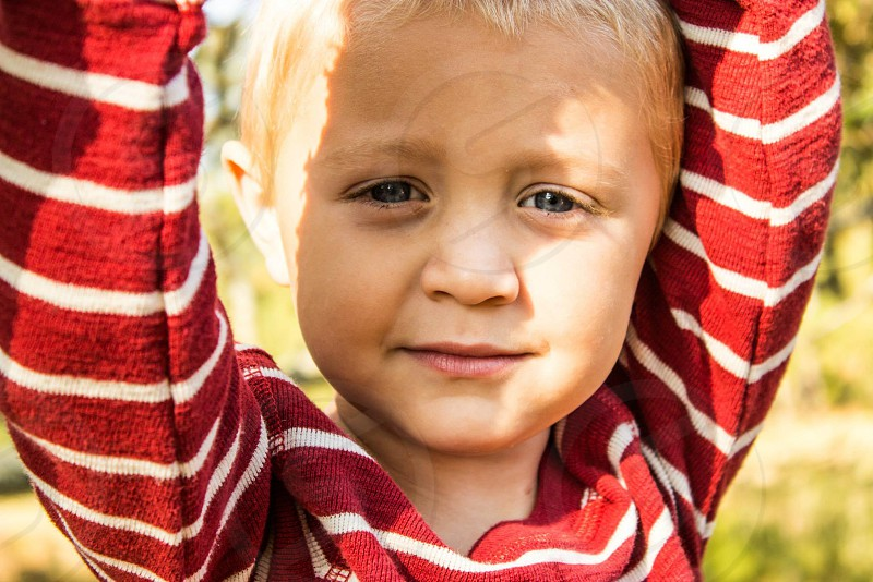 boy in red and white stripe long sleeve shirt photo