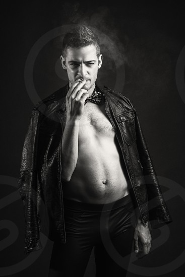 Young guy smoking a cigarette photo
