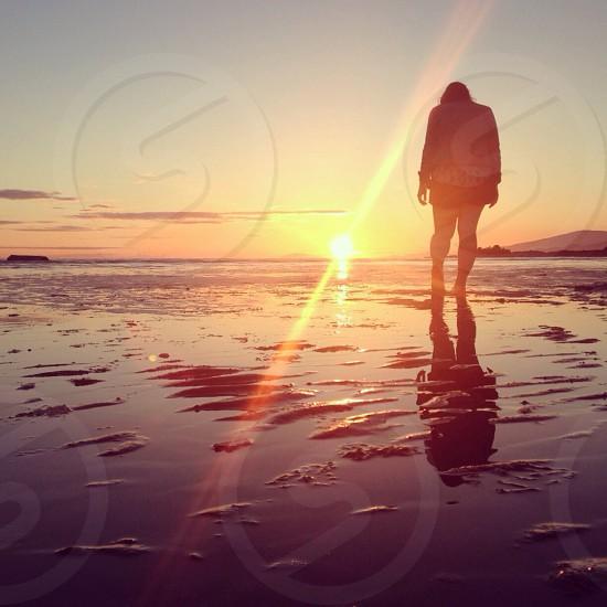 woman silhouette on sunset photo
