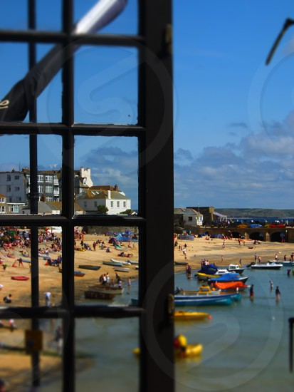 Photo taken through a window of Newquay a small coastal town in England photo