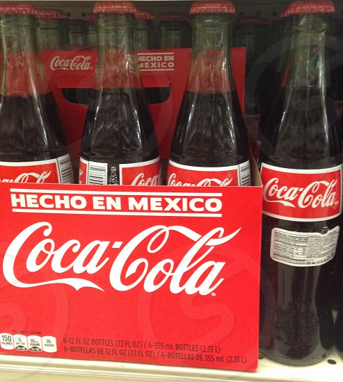 Coca-Cola bottles with red crate photo