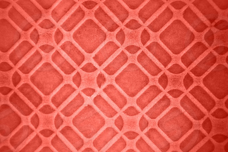 Geometric background from glazed ceramic tiles in a fashionable pantone trendy color of spring-summer 2019 season Living Coral. photo