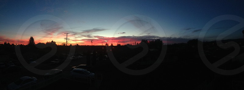 Panoramic picture of a colorful sunset. photo