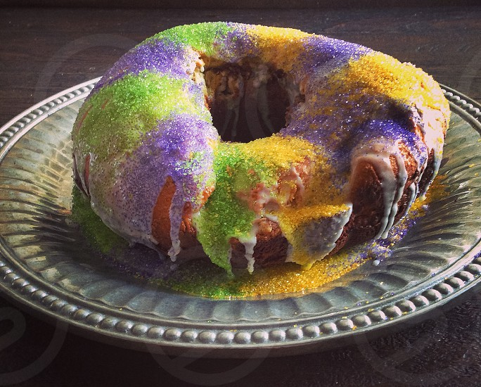 King cake Mardi Gras Fat Tuesday brioche homemade yellow purple green platter pewter photo