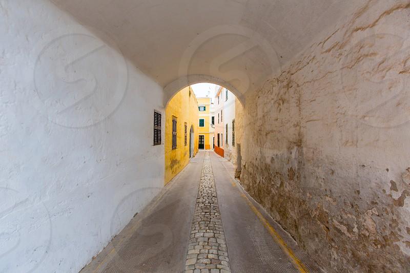 Menorca Ciutadella Carrer de Sant Climent barrel vault passage in Balearic islands photo