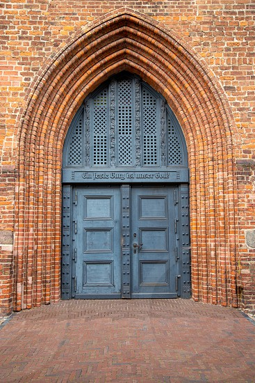 the old church door of St. Peter's Church in Wolgast at the baltic sea photo