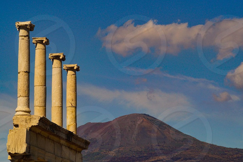 Mighty Vesuvius towering over Pompeii and some of its columns Italy photo