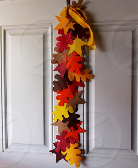 hanging brown red and yellow flower cut-out papers photo