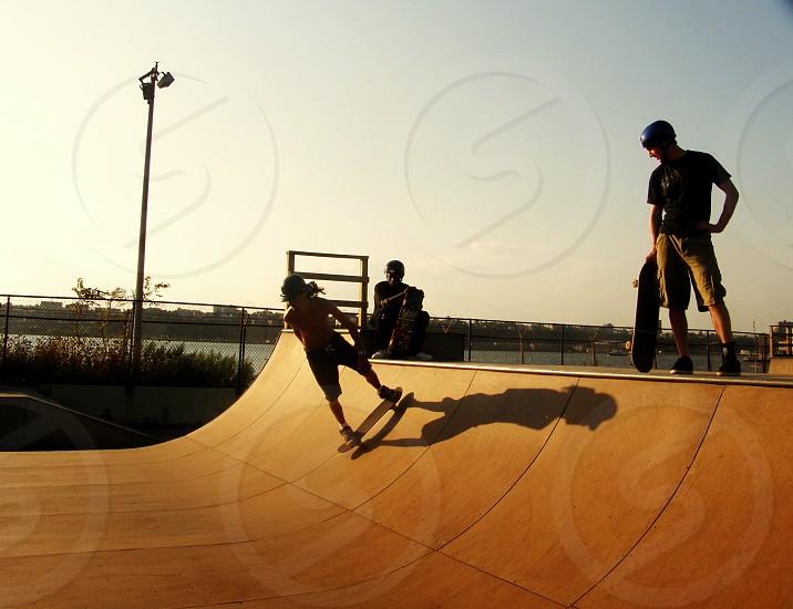 man standing beside man skating on skating ramp photo