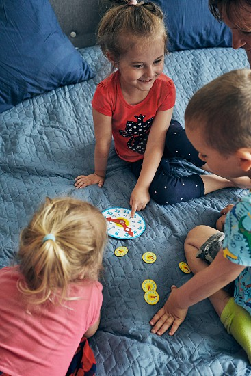 Kids learning how to tell time from clock and set the hands in the correct position. Teaching preschoolers tell time. Candid people real moments authentic situations photo