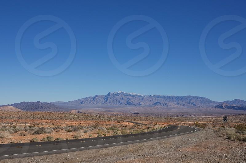 Utah desert road mountain range photo