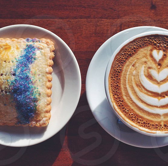 rectangular pastry bread and a cup with coffee art photo