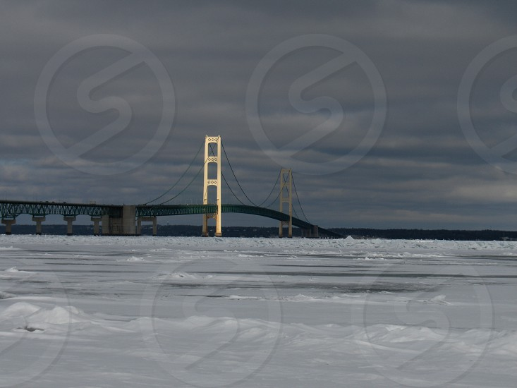 Mackinac Bridge ice winter partly sunny South tower sun lit photo
