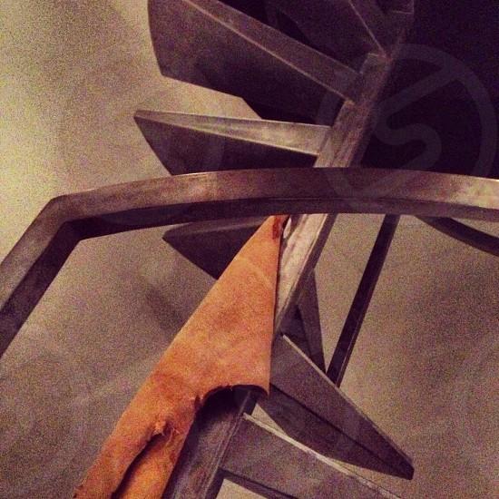 brown textile on grey metal frame photo