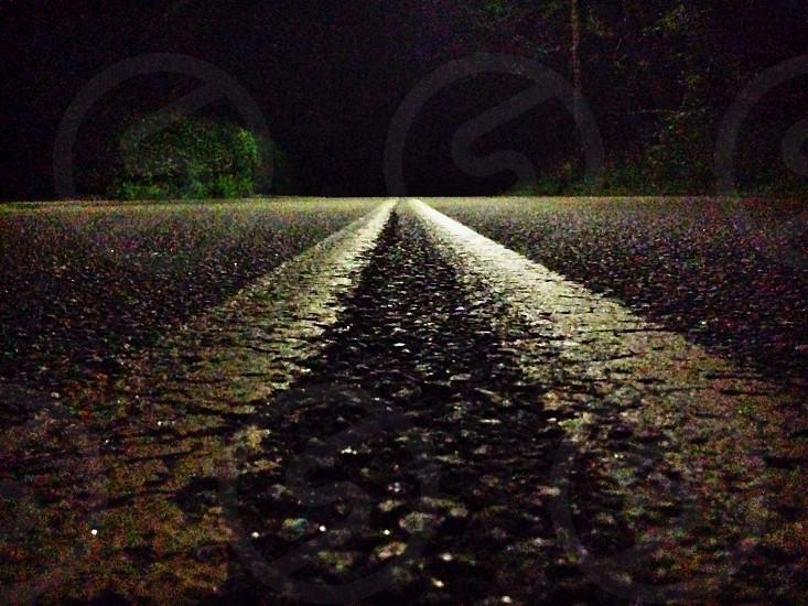 Street lines. Night time. Dark road.  photo