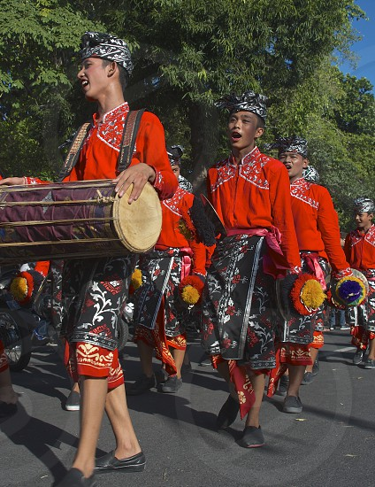 Bali parade singing drums traditional costumes music photo