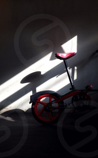 red and black bicycle with sun rays photo