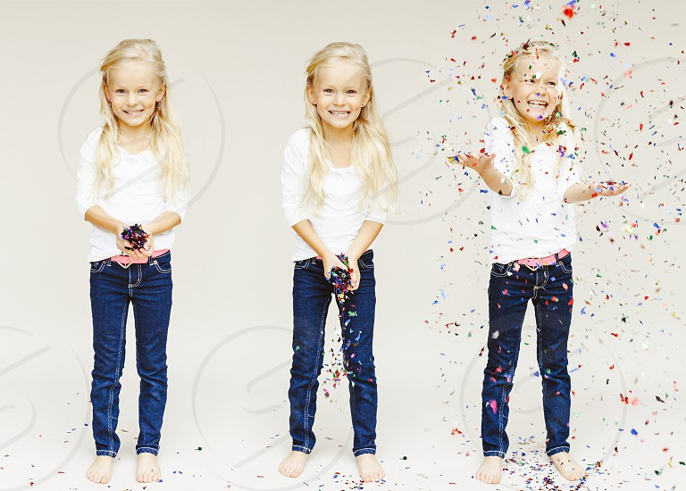 little girl throwing confetti photo