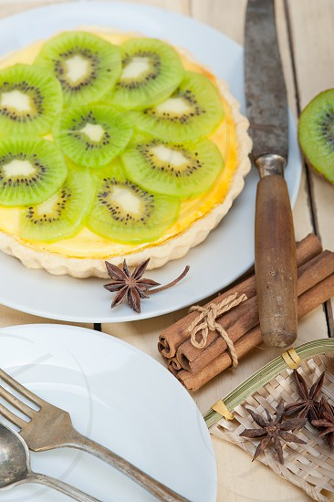 kiwi  pie tart with lemon custard cream and spices photo