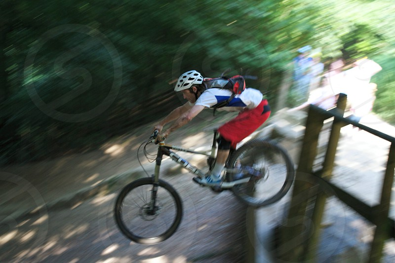 man in red white and blue clothes riding a mountain bike photo