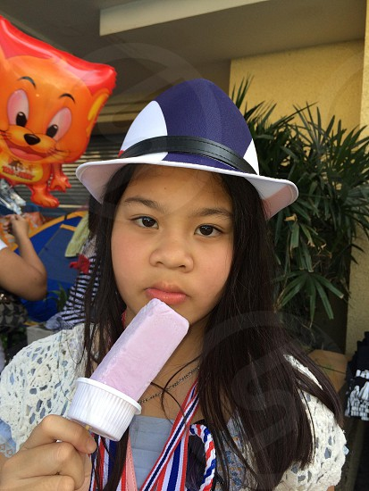 Close up portrait of Asian girl eating ice-cream photo