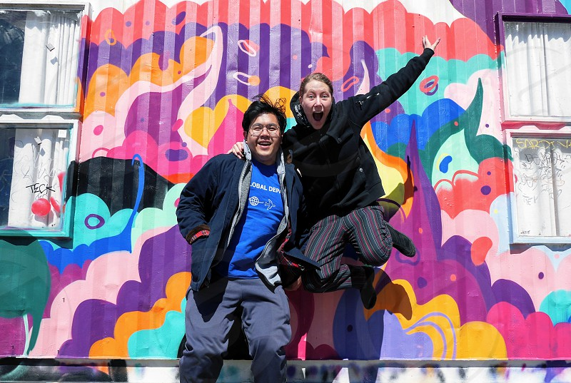 Best friends jumping photo fun colorful rainbow street art photo