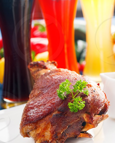original German BBQ pork  knuckle served with mashed potatoes and  sauerkraut with selection of beers and fresh vegetables on backgroundMORE DELICIOUS FOOD ON PORTFOLIO photo