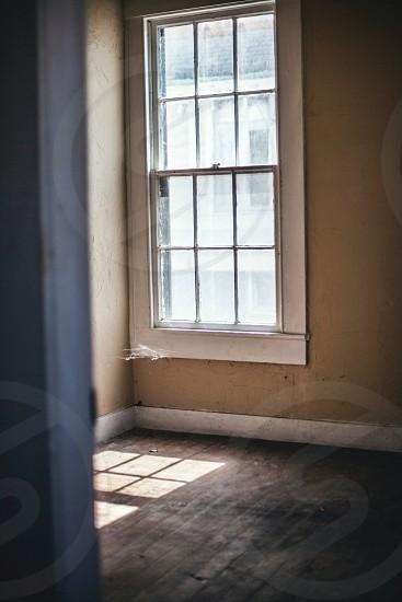 white framed clear glass window photo
