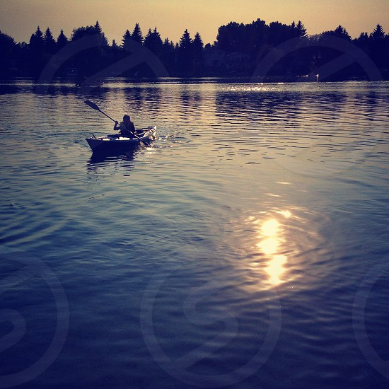 boy kayaking on a lake photo