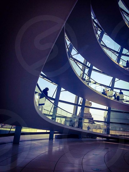 Indoor day horizontal colour atrium glass mirror reflect dome people tourists sightseers light shadow reichstag Berlin Germany deutschland politics parliament political tourism sightseeing travel wanderlust roof rooftop Europe European capital city walkway  photo